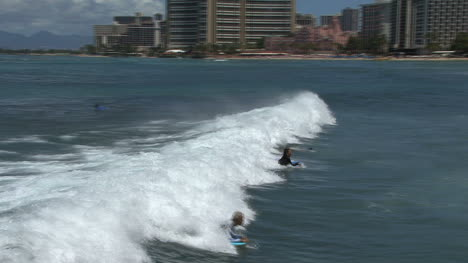 Waikiki-surfers-riding-a-wave
