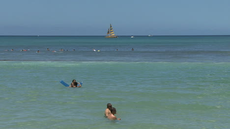 Waikiki-swimmers-reed-and-sailboat