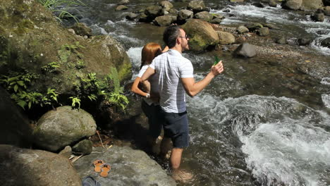 A-couple-by-a-river-in-Dominica