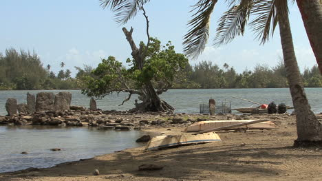 Huahine-sacred-site-and-beached-boats