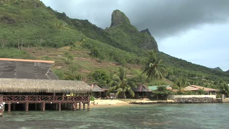 Moorea-thatched-building-and-peak-on-Cook's-Bay