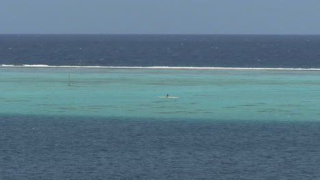 Raiatea-man-paddles-inside-reef-2