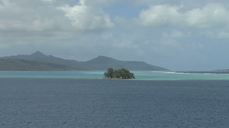 Raiatea-zooms-from-island-in-lagoon