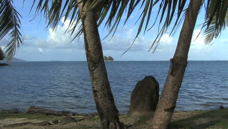 Raiatea-stone-and-palms-by-the-sea