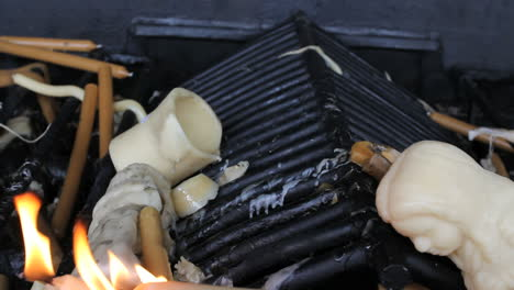 Fatima-wax-offerings-burning