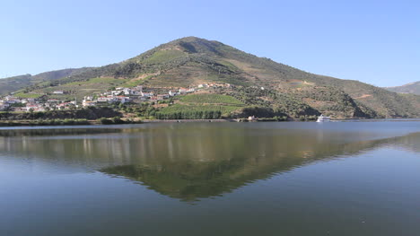 Boat-and-reflection-on-the-Douro-river-in-Portugal