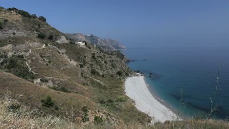 Spain-Nerja-narrow-white-beach-rugged-coast-1
