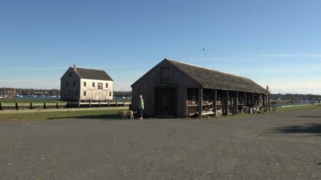 Massachusetts-Salem-boat-shed-walking-dog-sx