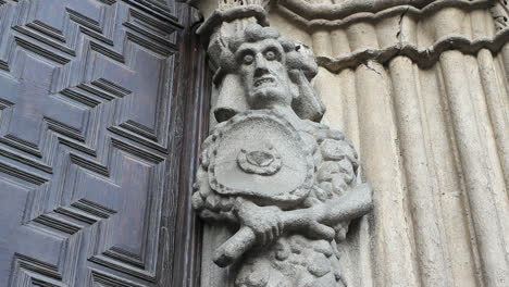 Spain-Castile-Avila-gruesome-statue-at-cathedral-door