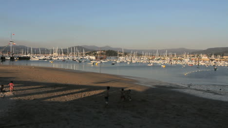 Spain-Galicia-Baiona-harbor-boys-playing