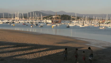Spain-Galicia-Baiona-harbor-beach-game