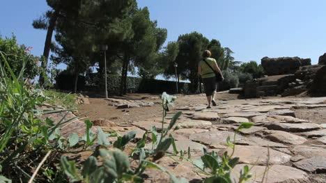 Spain-Extremadura-Merida-woman-on-Roman-road-2