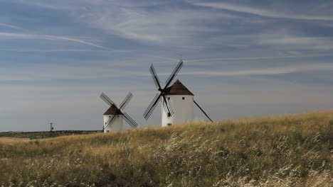 Spain-Mota-del-Cuervo-windmills-on-a-grassy-hill