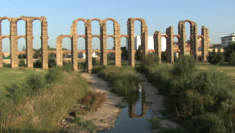 Merida-Aqueduct-of-the-Miracles-reflection-in-stream