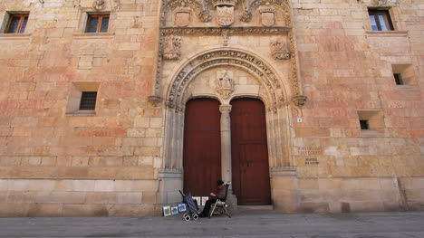 Spain-Salamanca-university-with-seated-man