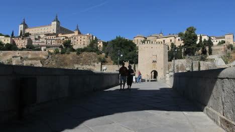 Toledo-Puente-de-Alcanrara-with-couple-walking