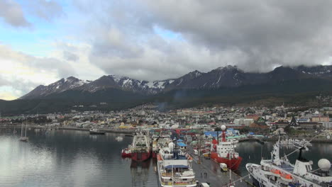 Argentina-Ushuaia-ships-on-wide-dock-and-mountains