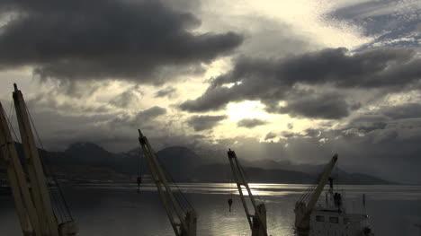 Argentina-Ushuaia-harbor-loading-cranes-and-sky-timelapse