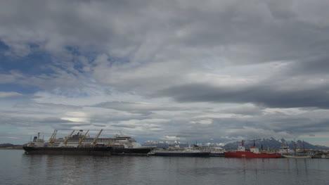 Argentina-Ushuaia-ships-docked-beneath-cloudy-sky