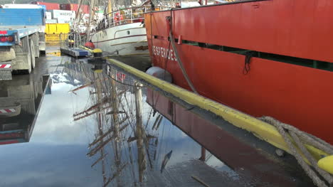 Argentina-Ushuaia-reflected-masts-and-red-hull
