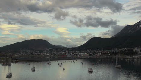 Argentina-Ushuaia-hills-curve-above-small-boat-harbor