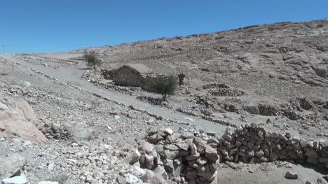 Chile-Atacama-Valle-de-Jere-stone-wall-and-house-2a