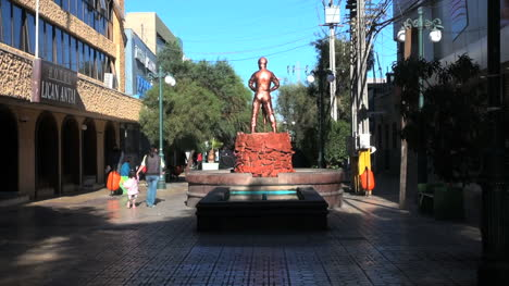 Chile-Calama-statue-miner-on-red-base-and-fountain-5