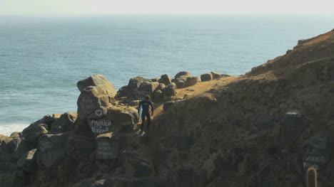 Chile-walking-down-a-cliff-at-Punta-Lobos