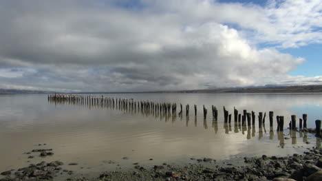 Puerto-Natales-row-of-posts-in-water-s