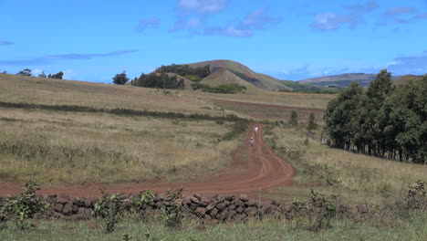 Easter-Island-Ahu-Akivi-hikers-on-red-dirt-road-1