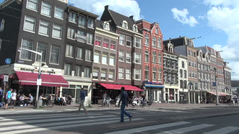 Netherlands-Amsterdam-awnings-cafe-and-gabled-houses