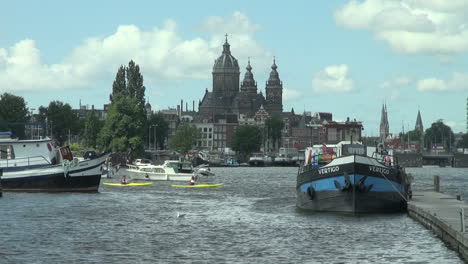 Netherlands-Amsterdam-blue-bow-domed-church-and-kayaks
