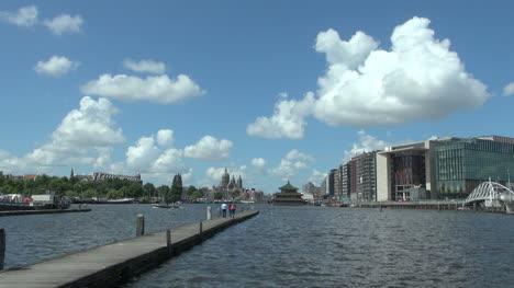 Netherlands-Amsterdam-people-walk-toward-end-of-pier