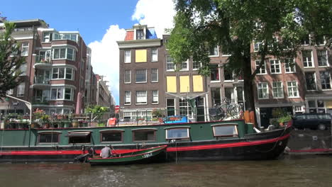 Netherlands-Amsterdam-passing-well-furnished-houseboat