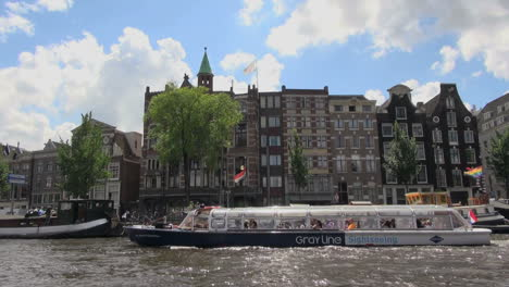 Netherlands-Amsterdam-black-and-white-canal-boat-moving
