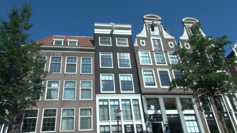 Netherlands-Amsterdam-moving-view-upward-gables-and-red-tiled-roof