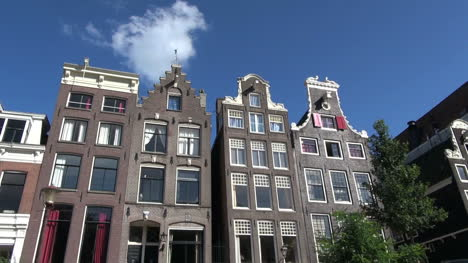Netherlands-Amsterdam-gabled-houses-pass-by