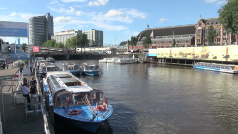 Netherlands-Amsterdam-boarding-a-glass-canopied-tour-boat