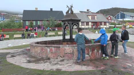 Greenland-Qaqortoq-fountain-with-boys