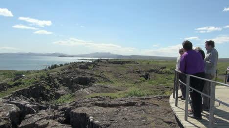 Iceland-Pingvellir-tourists-viewing-lake