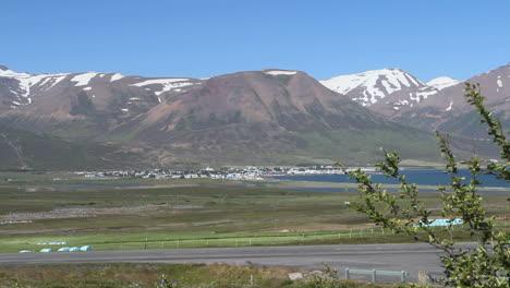 Iceland-Eyjafjordur-&-Davlik-village-below-mountains-c