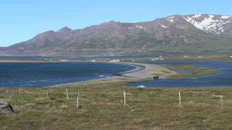 Iceland-Miklavaln-view-of-spit-and-mountains-c