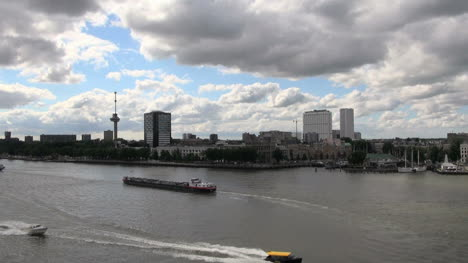 Netherlands-Rotterdam-barge-and-boats-pass-on-the-Maas