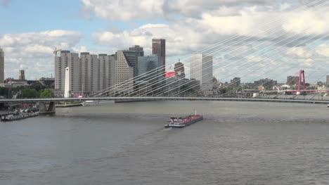 Netherlands-Rotterdam-barge-passes-under-suspension-bridge