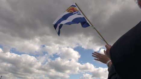 Netherlands-Rotterdam-waving-Zeeland-flag-against-clouds