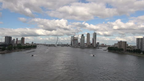 Netherlands-Rotterdam-boats-come-from-direction-of-Erasmus-Bridge