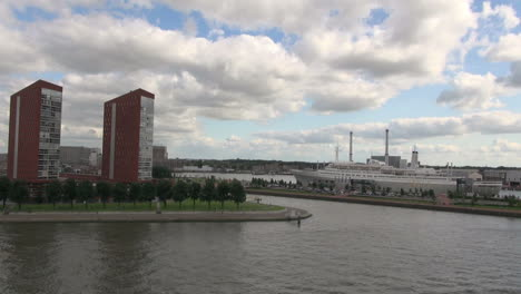 Netherlands-Rotterdam-waterside-maroon-apartments-and-docked-ship