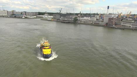 Netherlands-Rotterdam-river-yellow-fire-boat-turns