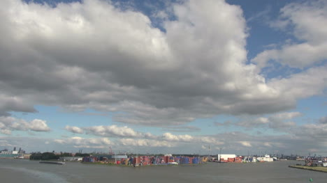 Netherlands-Rotterdam-clouds-over-colorful-containers-in-ship-yard