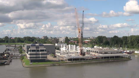 Netherlands-Rotterdam-two-cranes-tower-over-dockyard-island